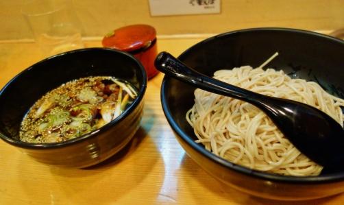 Dipping soba noodles into hot broth (Tokyo, Japan)