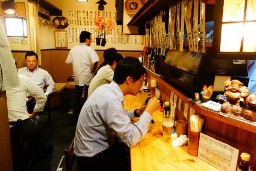 Locals in an izakaya (Ebisu district, Tokyo, Japan)